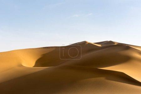 beautiful sand dunes, the setting sun shines on the desert