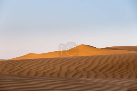 desert in sunset, beautiful sand waves and setting sun shone over the dunes