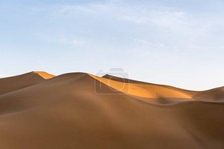 sand dunes illuminated by the setting sun, beautiful desert landscape