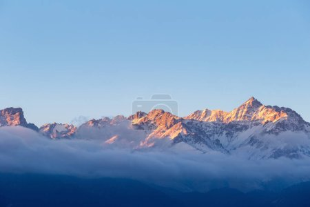 the peak in sunrise,golden sun shines on the top of tianshan mountains