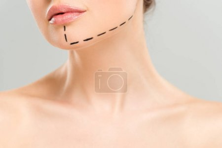 cropped view of naked woman with marks on face isolated on grey