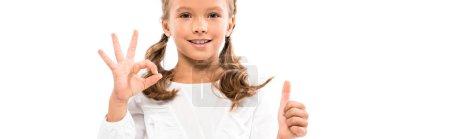 全景拍摄的快乐的孩子显示竖起大拇指和OK标志隔离在白色