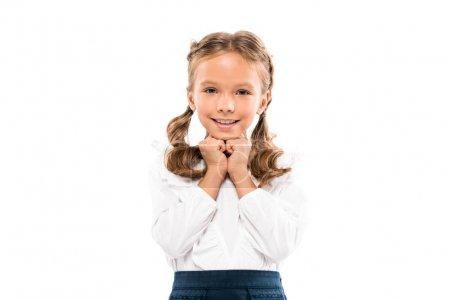 开朗的孩子看着相机和微笑孤立在白色