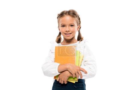 快乐的学童拿着书孤立在白色