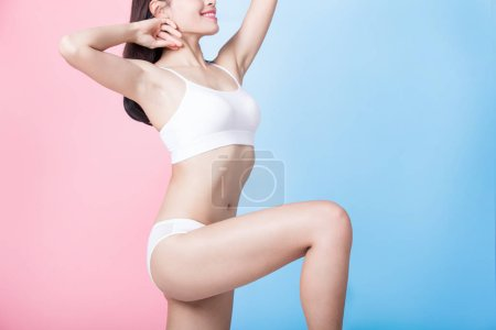 beauty woman posing on the blue and pink background