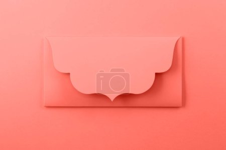 Color of year 2019 - Living Coral. Orange envelope on bright background.