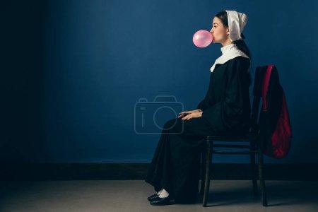 Medieval young woman as a nun