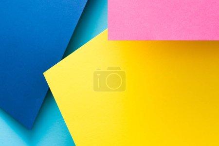 纸拼贴背景黄色蓝色粉红色层