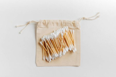 Natural bamboo ear sticks on cloth bag. Sustainable lifestyle. Zero waste, plastic free concept.