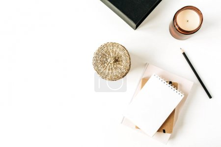 Neutral minimal office desk workspace with notebook on white background. Flat lay, top view.