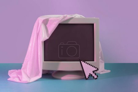 Vintage style concept with old Monitor screen and glitter fabric. Technology background. Retro fashion aesthetic.